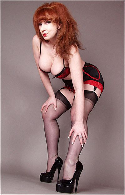 Ms Red in open bottom Franzini girdle and black stockings plays with her dildo at Red Xxx - redheadinstockings
