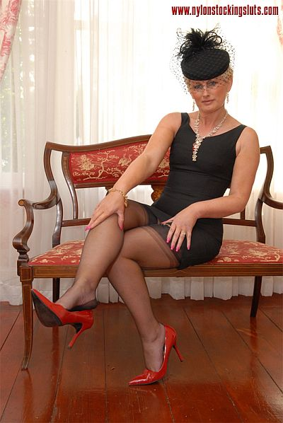 Horny Widow Sally Contemplates Masturbating In Her Black Nylon Stockings
