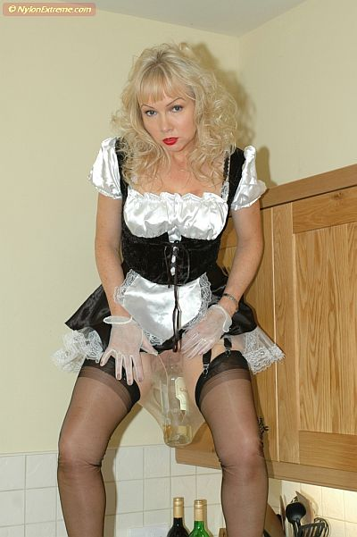 Maid Masturbates In Black Nylon Stockings
