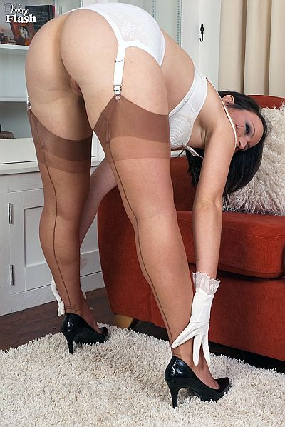 Lucy Love Bends Over In Her Seamed Nylons & Suspender Belt