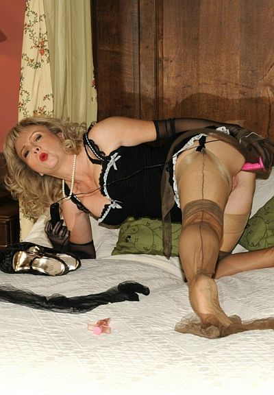 HOTWIFE SUE DRESSED IN LAYERS OF SEAMED STOCKINGS AND WANKING WITH A DILDO AT NYLON EXTREME
