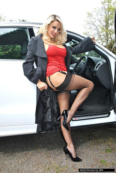 UK GLAMOUR MODEL DANNI HARDWOOD IN BLACK STOCKINGS SUSPENDERS AND HEELS