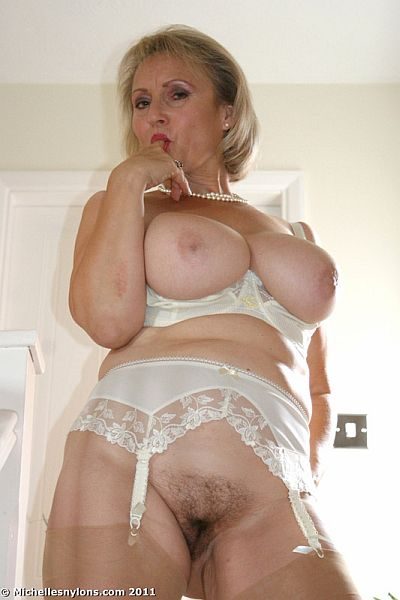 Mature Housewife Michelle Wanking Her Hairy Pussy In Nylon Stockings And Suspenders