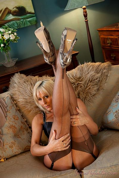 Jan Burton Mature English Tit Model Long Legs In Brown Seamed Nylon ...