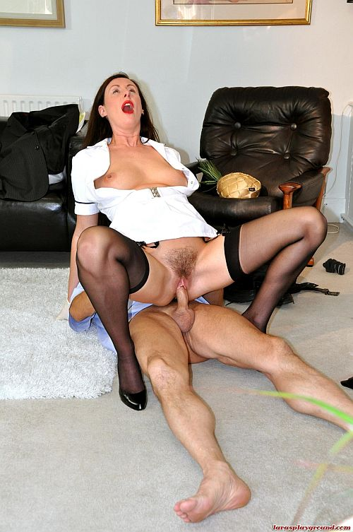 Brunette MILF In Nylon Stockings And Suspenders Fucked By Older Guy On The Living Room Floor
