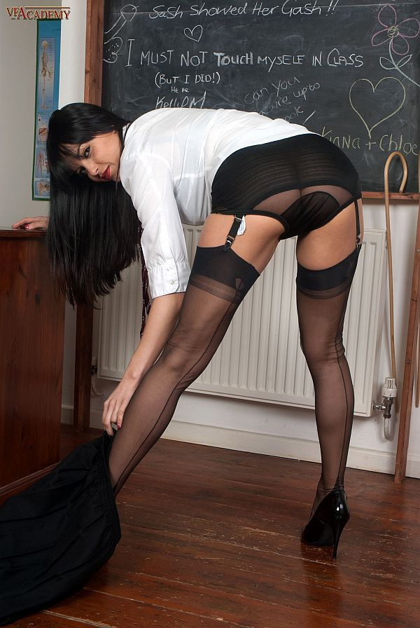 Sasha Cane – Sexy Schoolgirl Masturbating In Black Suspenders, Seamed Nylon Stockings And Heels
