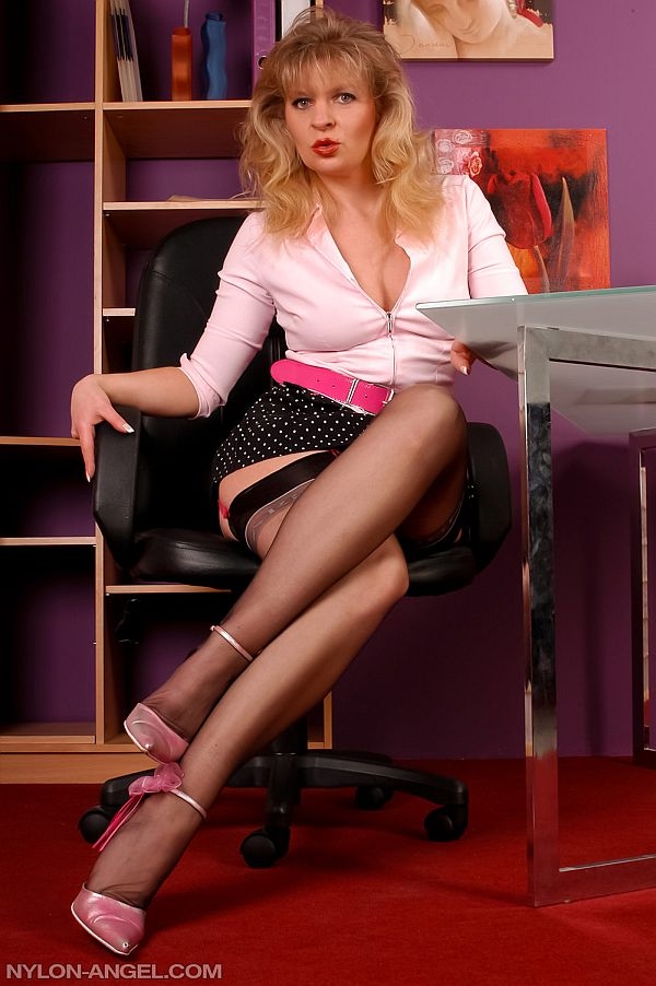Stockings Blonde In Black Seamed Nylons and Red Suspenders Teases With Her Feet In Heels