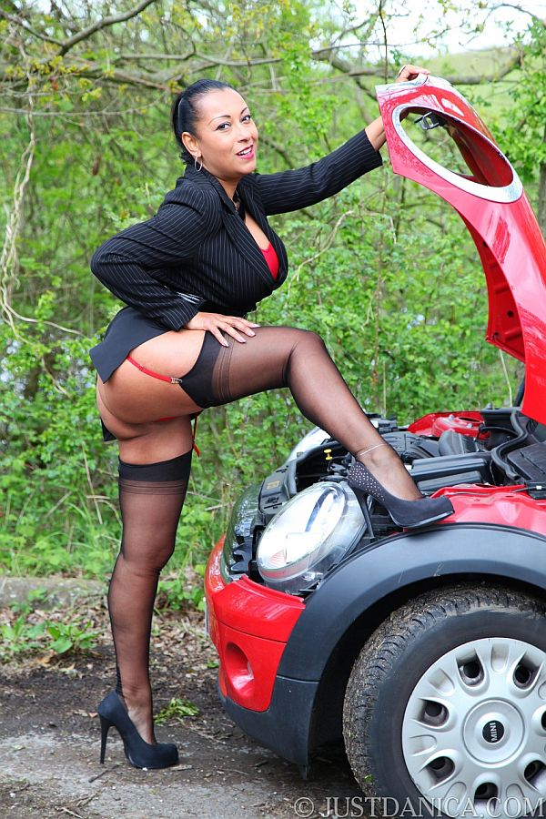 Busty Danica Flashing In A Country Lane In Nylon Stockings, Suspenders and Heels