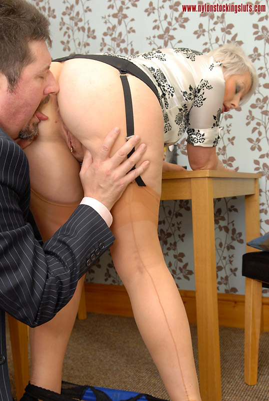 Horny secretary has sex in the office in sheer panties, nylon stockings and suspenders