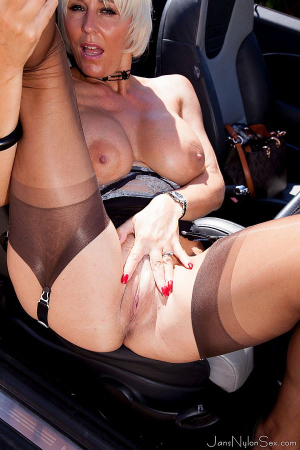 Jan Burton – Horny Milf In Car Flashing Her Black Suspenders and Tan Nylon Stockings