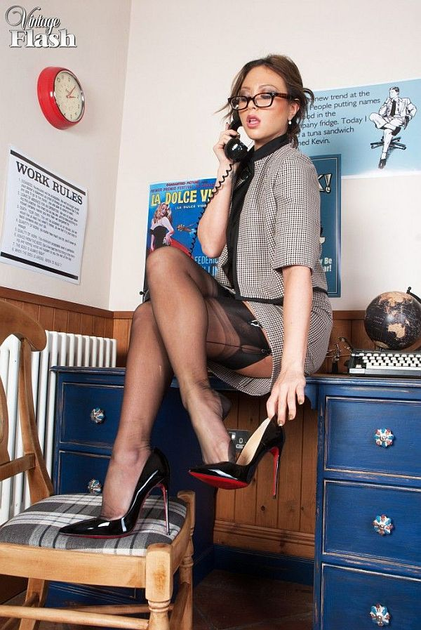 Horny Secretary Has Phone Sex In Black Suspenders, Seamed Nylon Stockings and Louboutin stiletto heels