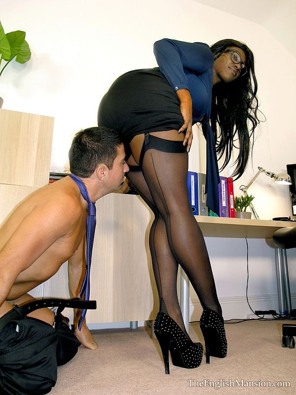 Dominant Ebony Secretary In Black Seamed Nylon Stockings and Stiletto Heels Makes Her Boss Worship Her Legs